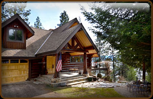 Looking for an impressive mountain log home overlooking the most breathtaking lake & scenery in North Idaho? Massive Caribou Creek Log Home.