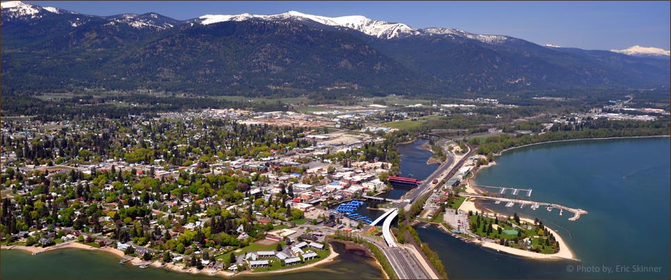 Sandpoint, Idaho with city beach in front and Schweitzer Mountain in back