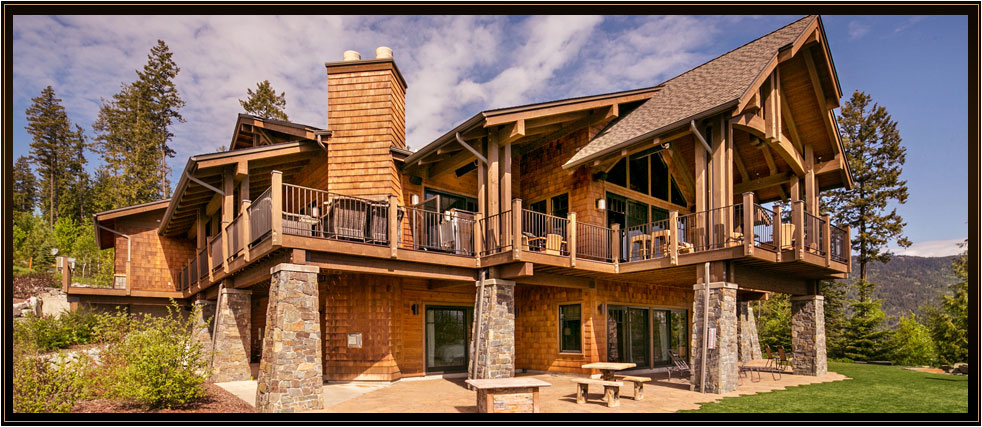 From the moment you arrive at the 40 foot porte cochère of this residence, the colonnade design of quarter sawn fir beams welcomes you into this unique North Idaho timber-framed home with impressive Sandpoint City and Lake Pend Oreille views