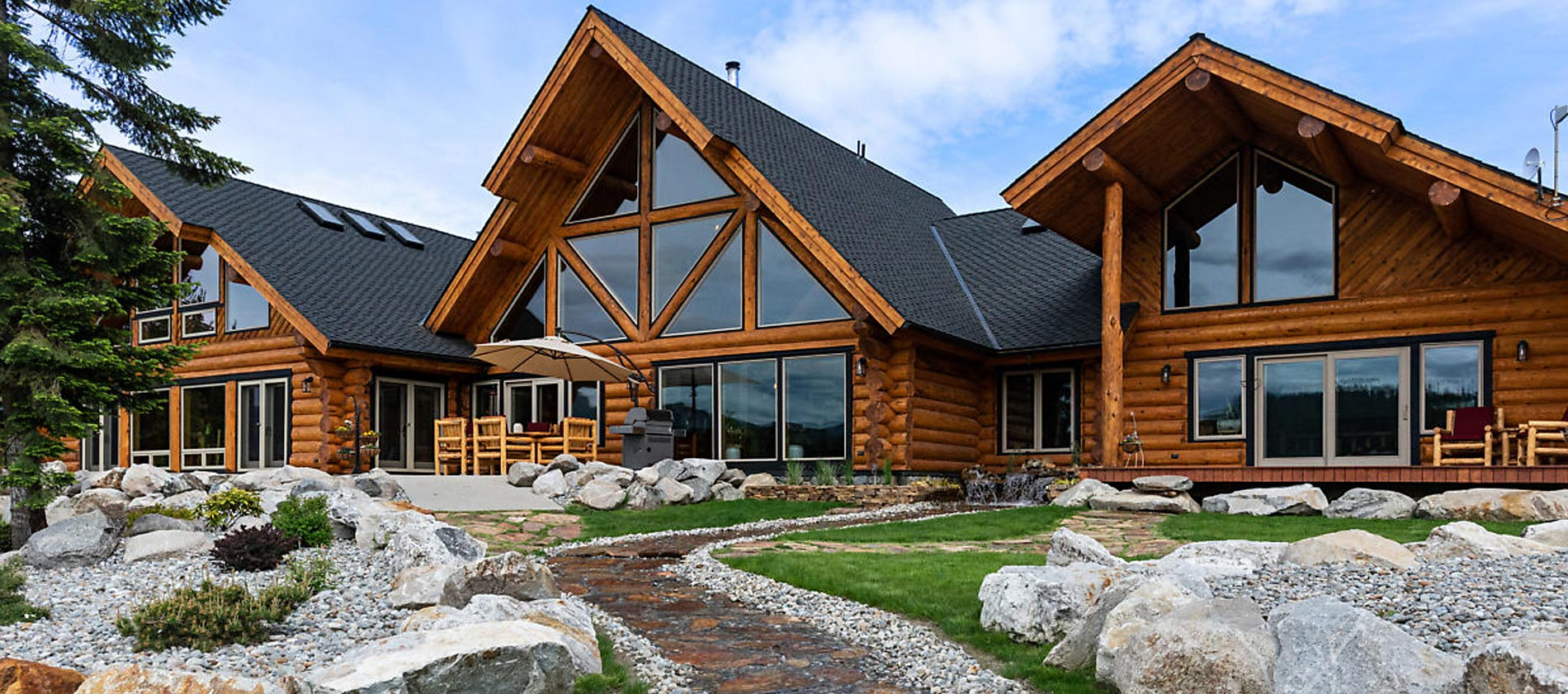 private waterfront estate with a pond at the end of the road to your magnificent custom log home. Caribou Creek